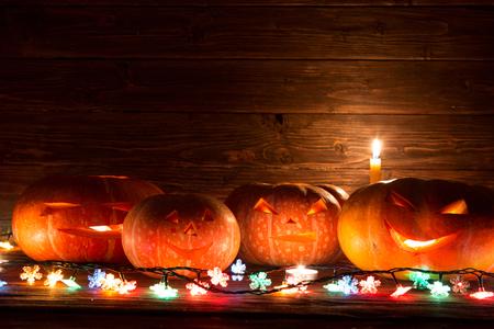 Halloween pumpkin head jack lantern on wooden background. Halloween pumpkin background.
