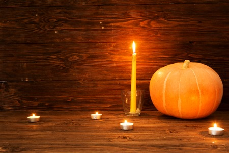 Happy Thanksgiving Day background, wooden table with Pumpkins and Candles. Stock Photo