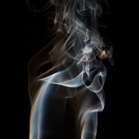 Smoke isolated on dark background. Abstract fumes.