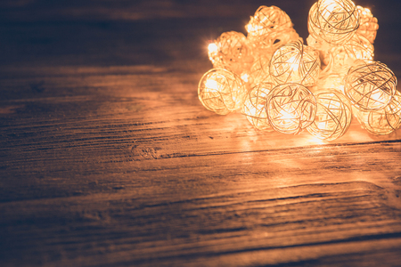 Christmas lights on wooden surface. Christmas or New Year concept. Stock Photo