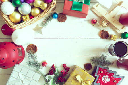 Christmas decoration background: pine and gifts with on white wood table.