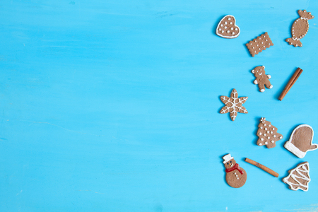 Christmas baking background. Christmas gingerbread cookies and spices on blue table. Top view. Stock Photo