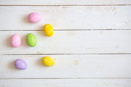 Colorful easter eggs old white wooden board.