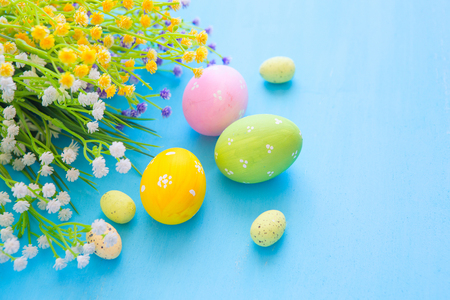 Easter eggs decoration on a wooden table.