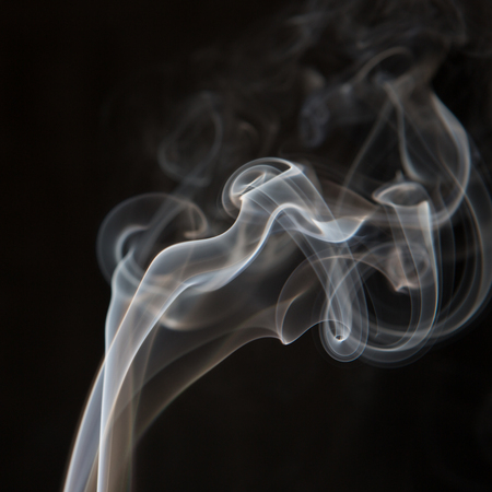 Smoke on black background close up. Abstract fumes.