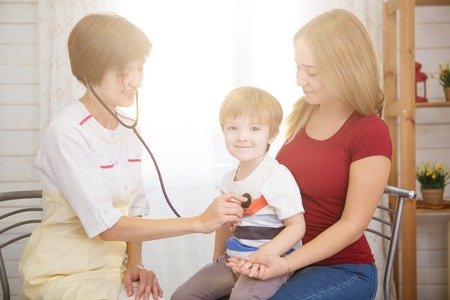 Pediatrist examinate young patients lungs with stethoscope. Stock Photo