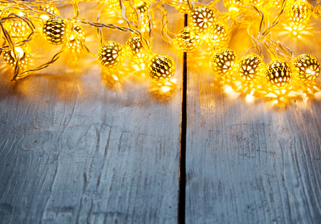 Background with lights for festive events in front of a wooden table.