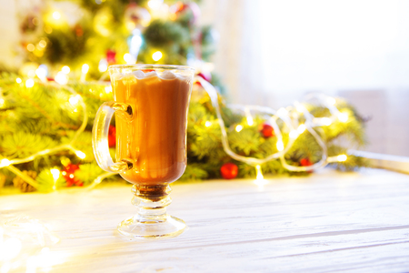 A cup of hot chocolate with marshmallows on a Christmas table. Standard-Bild - 114141371