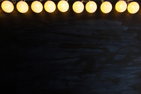 Christmas light on black background with copy space. Standard-Bild - 114141375