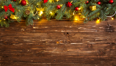 Christmas decoration over brown wooden background. Decorations over wood. Standard-Bild - 114141381