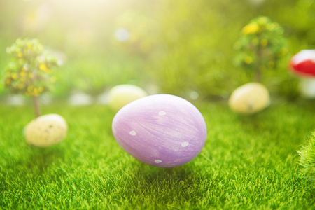 Lilac easter egg on green grass in the Dreamland