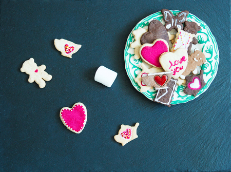 ?ookies on a black stone background Saint Valentine's Day holiday. Stock Photo