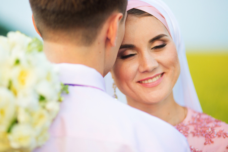 National wedding. Bride and groom in the field. Wedding muslim couple during the marriage ceremony. Muslim marriage.