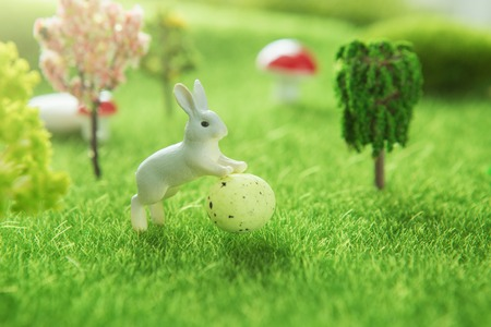 Spring meadow with a rabbit and easter egg. Fairy tale Reklamní fotografie