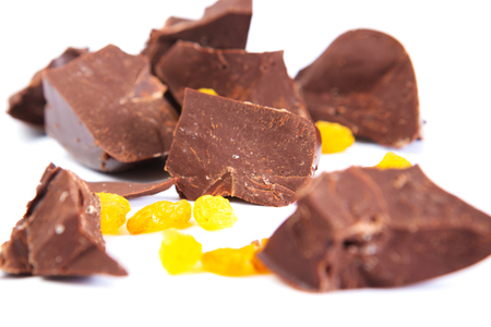 Chocolate with raisins on a white background