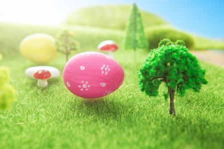 Easter egg hunt with pink colored egg in a Dreamland or fairy world. Reklamní fotografie