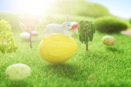 Yellow easter egg spring meadow with rabbit and easter eggs. Fairy tale