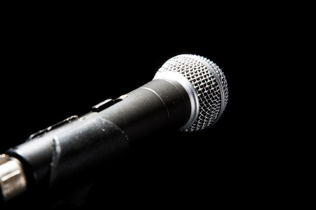 Microphone in a Black background. Music and concert concept.