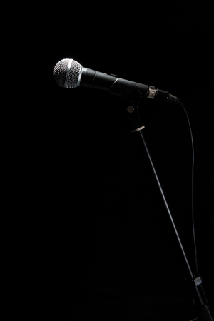Microphone isolated on black background. Music and concert concept.