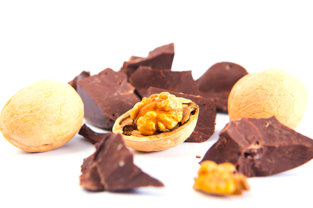 Chocolate with walnuts on a white background Banque d'images