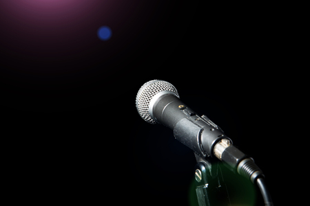 Microphone isolated on black background. Music and concert concept. Banco de Imagens