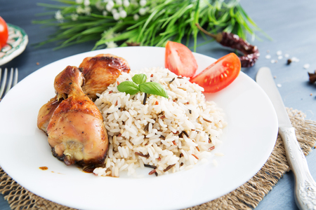 Rice with chicken on a serving gray table