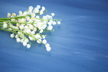 Wonderful fragrant white flowers with a delicate scent. Lily of the valley flowers on gray wooden or metal table Stock Photo