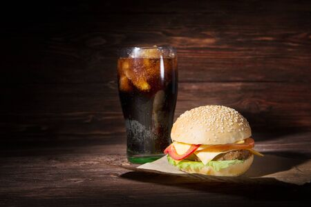Homemade burger and Cold drink cola on wooden surface background