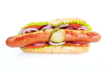 Delicious fast food. Hot dog with lettuce and tomato on white background Banco de Imagens