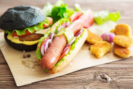 Delicious fast food. Fast food plate with burger and hot dog Stock Photo