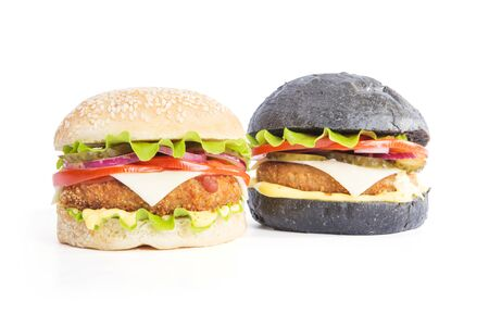 Delicious fast food. Two delicious burgers black and white, isolated on white background 版權商用圖片