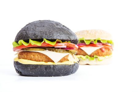 Delicious fast food. Two delicious burgers black and white, isolated on white background Stock Photo