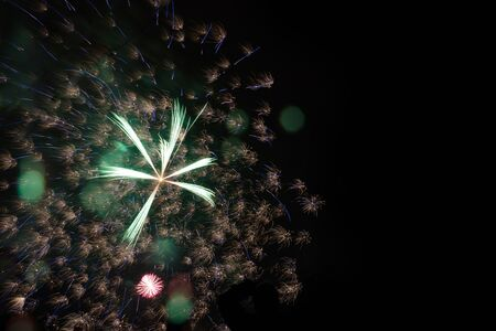 Colorful fireworks explosion in annual festival on background. Great holiday of a great country. The celebration of Independence Day in the United States of America. 4th of July. Stock Photo