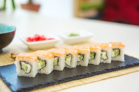 beautiful, bright, sushi sets,as a background, against the backdrop, closeup Healthy and tasty food.