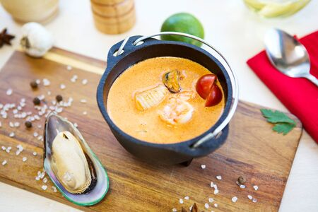 Restaurant cuisine, healthy delicatessen seafood soup on a cutting board. Healthy and tasty food.