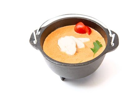 Metal pot of fresh made Creme Soup with chicken on white. Healthy and tasty food. Stockfoto