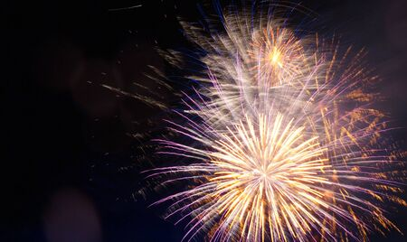 Festive fireworks display lit up over night sky. Celebration concept. Copy space. . Great holiday of a great country. The celebration of Independence Day in the United States of America. 4th of July. Stock Photo