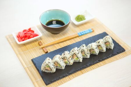 Sushi roll with salmon and shrimp tempura Healthy and tasty food. Stock Photo