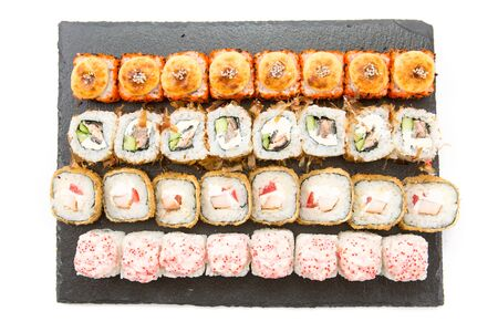 Various kinds of sushi served on black stone Healthy and tasty food. Stock Photo