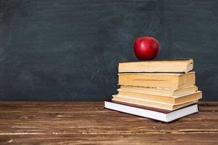 Red apple over pile of books for shool concept. Education concept, toned and soft focus image 版權商用圖片