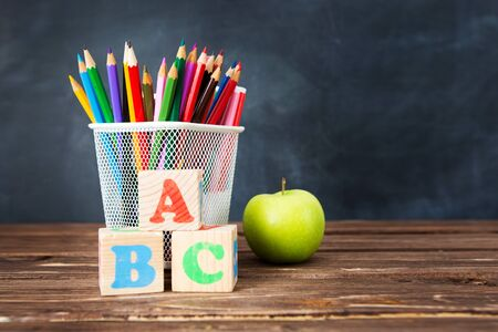 School supplies on blackboard background. The concept of education, study, learning, elearning. Back to school concept 版權商用圖片