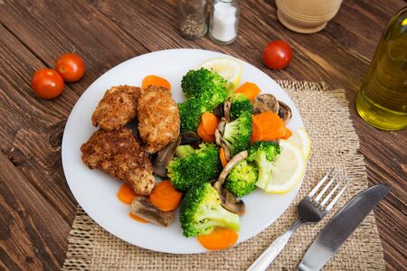 Healthy food made of broccoli, mushroom and carrot.