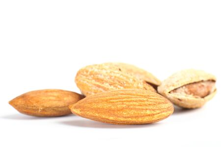 Almond nut in shell isolated on white background close up Фото со стока