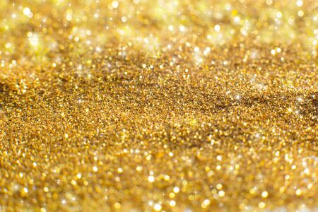 Christmas Glittering on gold background.