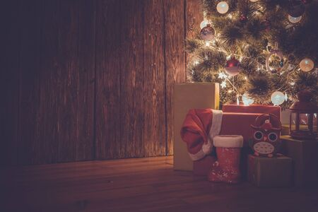 Colorful presents and the christmas tree. Christmas background. Stock Photo
