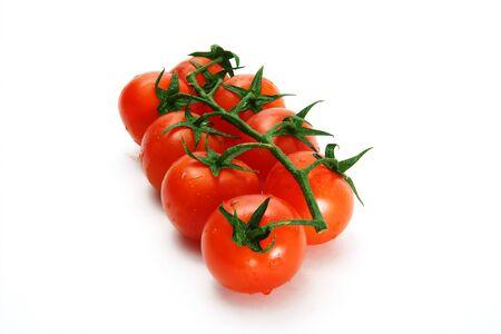 Delicious red tomato cherry on a white background. Stock fotó