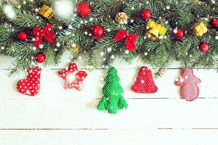 Christmas decoration on white old grunge wooden board. Decorating and christmas tree