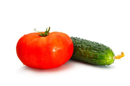 Delicious red tomato and cucumber isolated on a white background. Stock fotó
