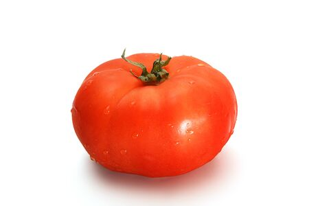 Delicious red tomato on a white background.