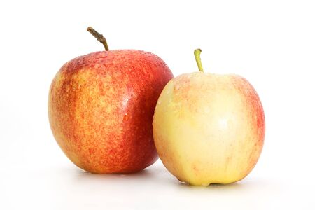 Delicious appetizing beautiful fresh two red apples isolated on a white background.